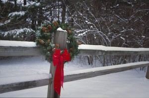 Michigan. Farmington Hills. Christmas wreath in a snowy fence. Wintertime scenics and holiday spirit.